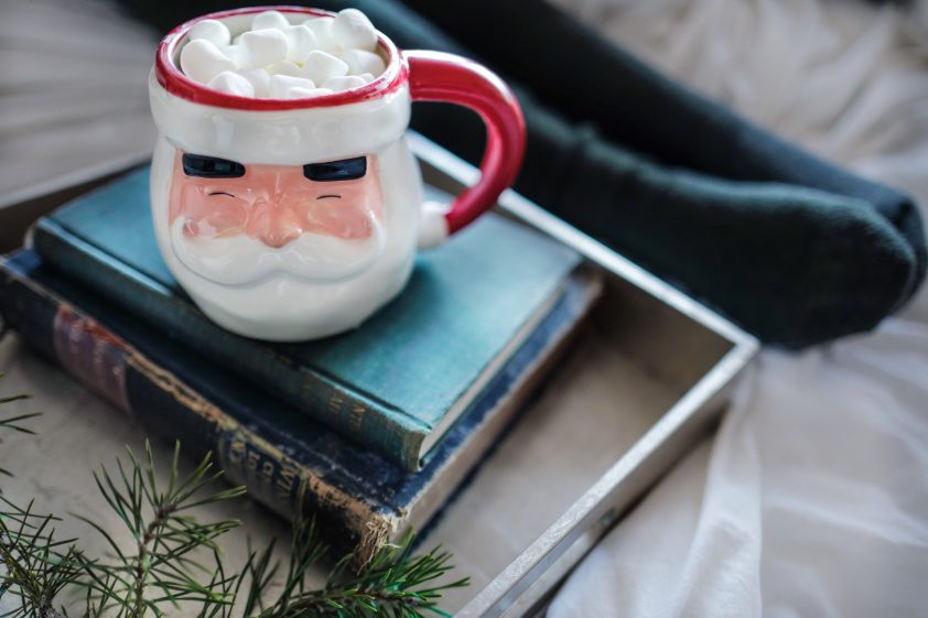 Santa Clause mug filled wit hot chocolate and marshmallows