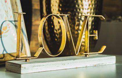 Brass love sign