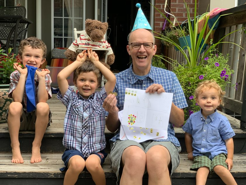 Happy father on celebrating his birthday with kids