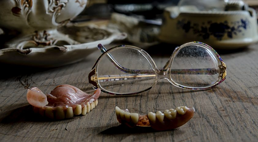 Scary teeth and glasses decoration for Murder Mystery experience