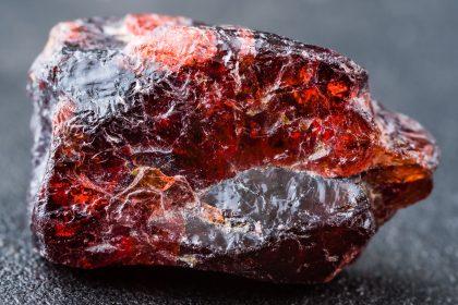 Uncut and rough deep red rhodolite garnet gemstone