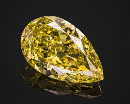 Pear cut yellow diamond