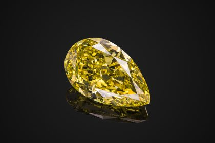 Pear cut yellow diamond transparent gemstone