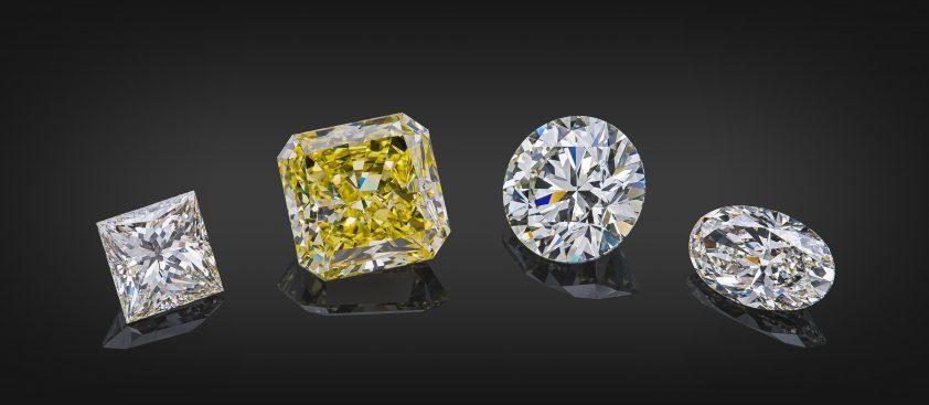 Sparkling yellow diamond amongst colourless various cut shape diamonds
