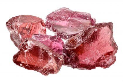 A pile of purple red rhodolite garnet gemstone crystals uncut