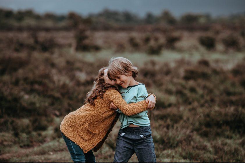 Sister hugging her brother