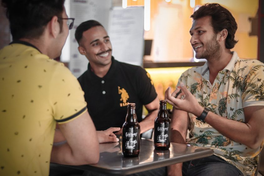 Men laughing over a beer