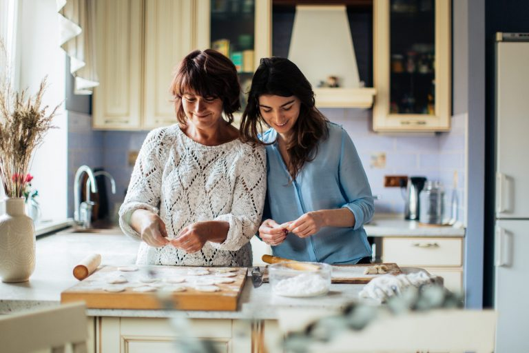 Mother-in-law baking with her daughter-in-law