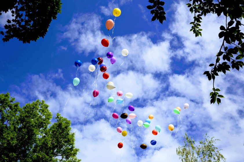 Happy birthday balloons being released for cousin in heaven