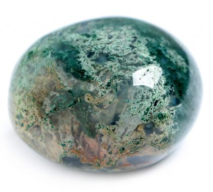 Beautiful moss agate gemstone on white background