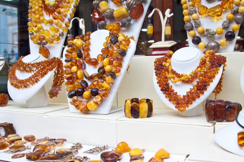 Counter with amber jewelry for sale in store window