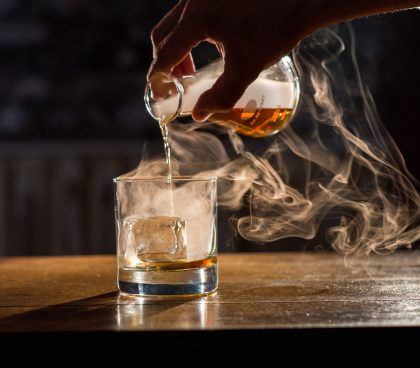 Premium whisky being poured over ice at Bull in a China Shop