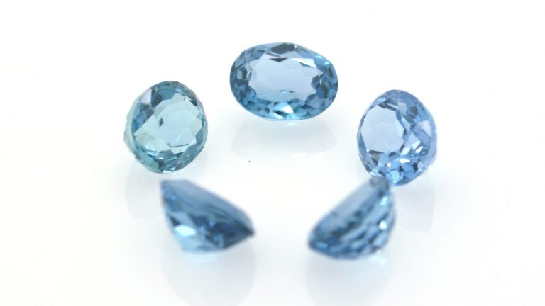 Group of beautiful and bright blue London topaz.