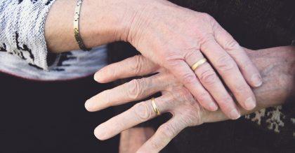 55th wedding anniversary photo featuring their wedding rings