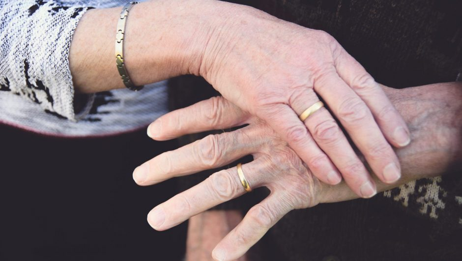 55th wedding anniversary photo featuring their wedding rings