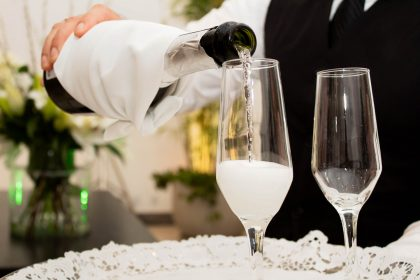 Champagne being poured into crystal flutes