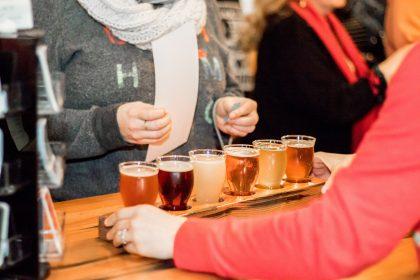Woman enjoying craft beer tasters