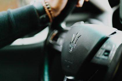 Man driving a Maserati car