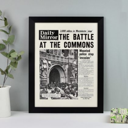 A quality reprint of the front page of an original national newspaper for a given date.