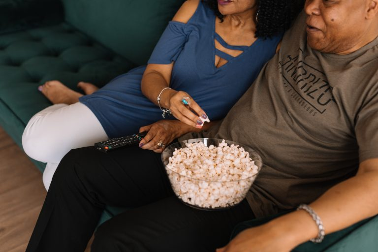 Couple having a movie night at home on Valentine's Day