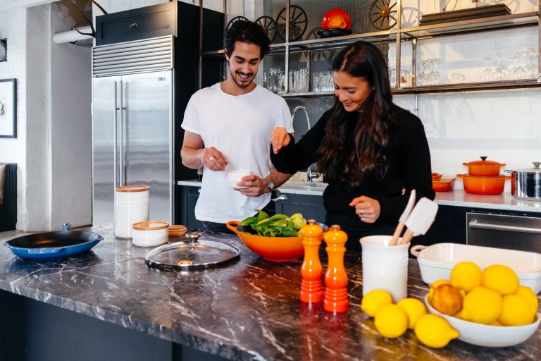 Young couple cooking in kitchen with meal kit