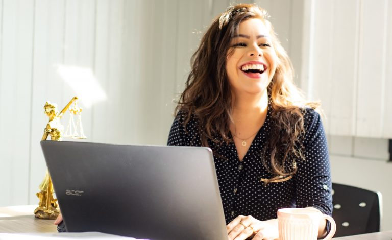 Working woman thinking positively