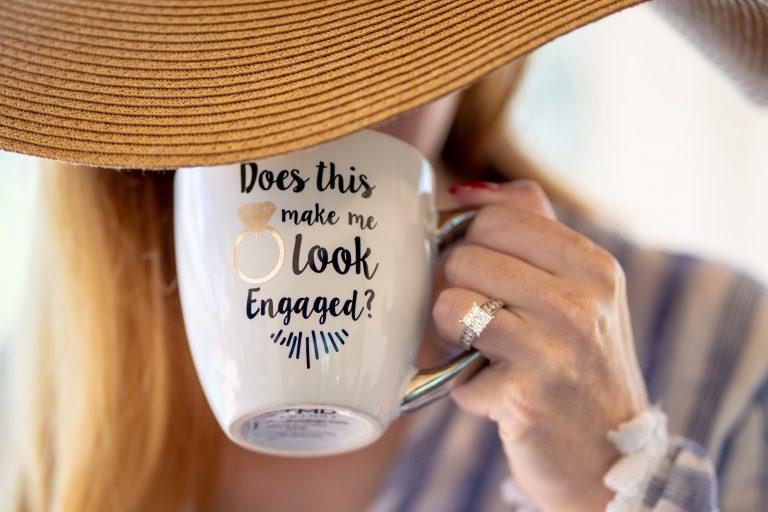 Woman holding engagement mug