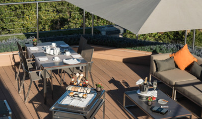 Rooftop Romance: Private Sunset Dinner With Champagne For Two at  Hotel Xenia, Autograph Collection